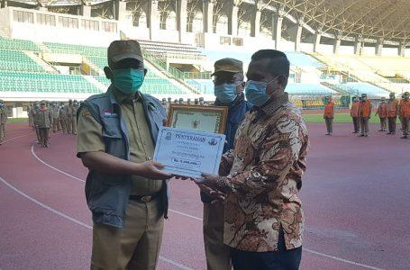 Penghargaan Purnabhakti dan Penyerahan Jaminan Kematian Peserta BPJS Ketenagakerjaan RT RW Kader Posyandu